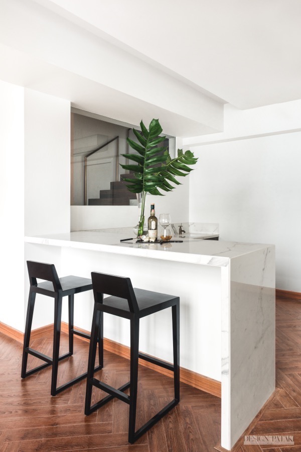 The black Duko chairs complement the neutral bar area